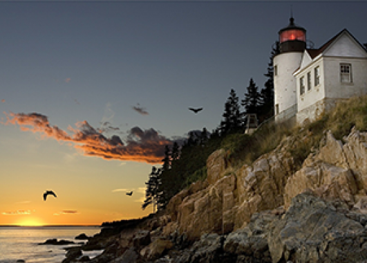 lighthouse on the rocky coast of New England.
