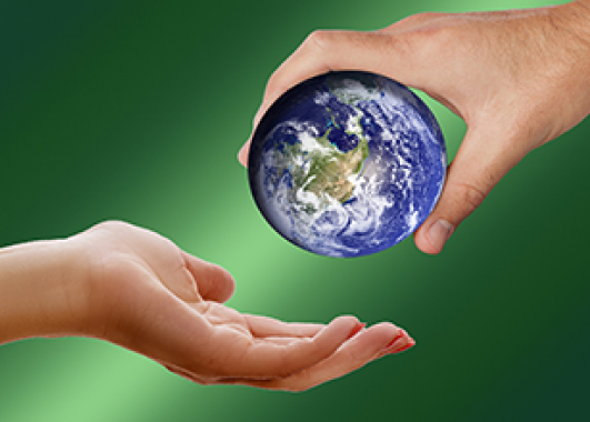 a person's hand passing a small sized Earth to another person's hand.