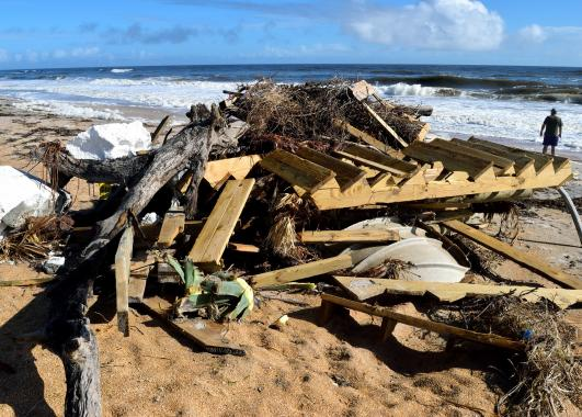 a pile of various debris on a beach.