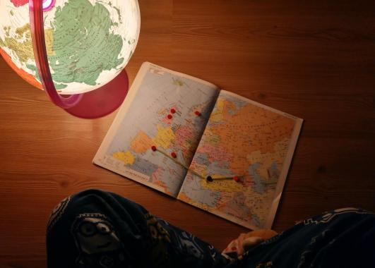 Image of a map and a globe